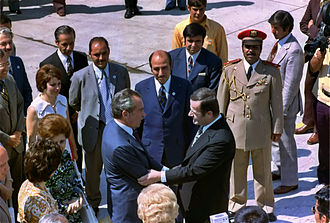 Hafez al-Assad greets Richard Nixon on his arrival at Damascus airport in 1974 NixonAssad.jpg