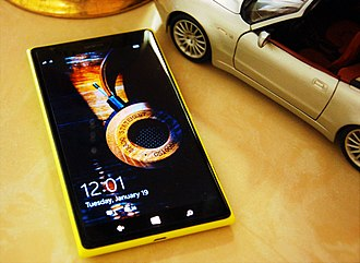 Nokia Lumia 1520 - Image: Nokia Lumia 1520 next to a 1 18 scale model of a Maserati Spider