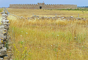 Öland - Stora Alvaret on southeast of Öland with Eketorp Fortress in background