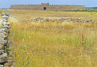 Stora Alvaret - Stora Alvaret on southeast of Öland with Eketorp Fortress in background.