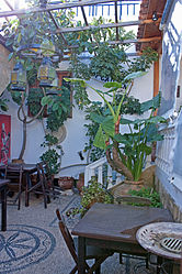 Outdoor café in Lindos, Rhodes 2.jpg