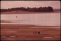 PEOPLE WALK A BEACH UNCOVERED DURING A RECORD LOW FLOW OF THE COLUMBIA RIVER AT ROOSTER ROCK STATE PARK 18 MILES EAST... - NARA - 555403.tif