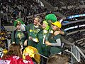 Packer fans resplendant in green (6807216883).jpg