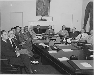Leo Crowley - Crowley (center, 7th from left or right) in a meeting of Truman's cabinet (August 1945)