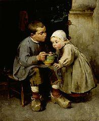 A Boy Feeding his Little Sister