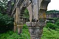 Pillars of a ruined building at Vijay Garh Fort.jpg