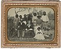 Plantation owner with his wife and servants (8415569369).jpg
