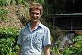 Portrait of Solomon Water volunteer Louis Downing in front of the Kongulai water supply. (10714234955).jpg