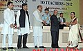 Pranab Mukherjee presenting the National Award for Teachers-2012 to Smt. Indrasena R. Shirodkar, Goa, on the occasion of the 'Teachers Day', in New Delhi. The Union Minister for Human Resource Development.jpg