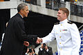 President Barack Obama shakes hands with a graduate of the U.S. Naval Academy during the school's 2013 graduation and commissioning ceremony May 24, 2013, at Navy-Marine Corps Memorial Stadium in Annapolis 130524-N-GK053-159.jpg
