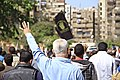 Protesters march through Cairo holding up four-fingers as a hand sign in memory of 2013 deadly crackdown on supporters of ousted President Morsi - 28-Mar-2014.jpg
