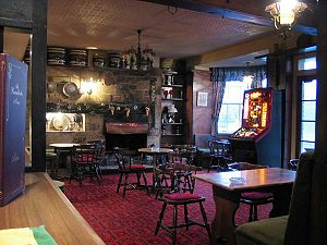 The interior of a typical English pub, in this...
