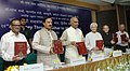"Ram Nath Kovind and the Minister of State for Culture (Independent Charge), Tourism (Independent Charge) and Civil Aviation, Dr. Mahesh Sharma releasing the ""Second Part of Volume-II of Pali Hindi Dictionary"", in New Delhi.jpg"