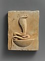 Relief plaque of cobra on a neb basket MET DP236813.jpg