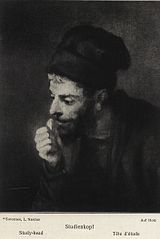 Man in a Beret looking Left showing a Fist
