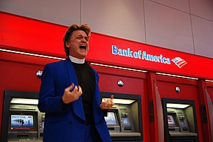 Reverend Billy and the Church of Stop Shopping - Reverend Billy attempting to exorcise bad loans and toxic assets from the Bank of America ATM in Union Square, New York City. 2009