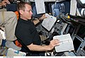 S125-E-006645 - Gregory C. Johnson working at the Commander's station of Atlantis during STS-125.jpg