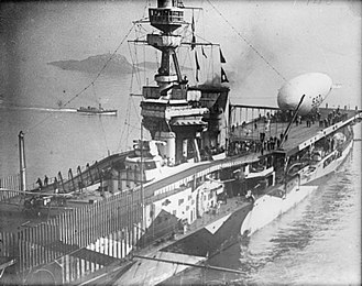 HMS Furious (47) - Closeup of the ship shortly following its initial conversion and in dazzle paint scheme. An SSZ class blimp is on the after deck