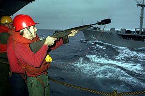 Sailor firing M14 line from CV-63 to USNS Kawishiwi (T-AO-146) 1983.JPEG
