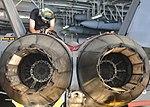 Sailor places an aft expendable pin on an aircraft aboard USS Nimitz. (36450298671).jpg