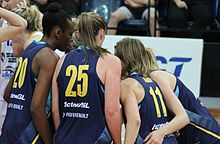 women in huddle
