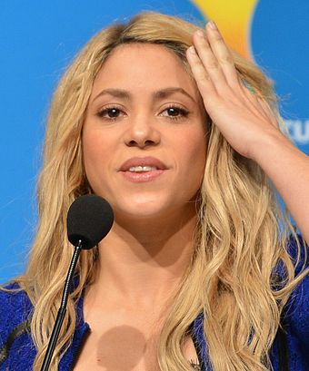 Shakira at a press conference for the 2014 FIFA World Cup closing ceremony Shakira 2014.jpg