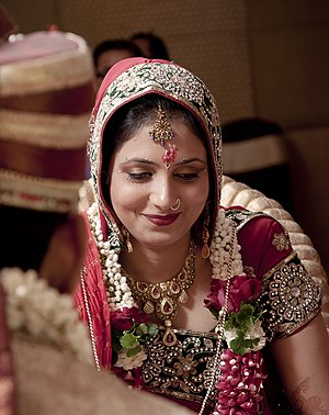 Weddings in India - Image: Shy smile of a bride in a Hindu wedding