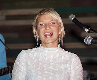 Chained to the Rhythm -  Sia Furler (pictured) co-wrote the song with Perry and contributes with background vocals.