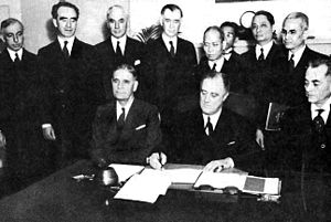Commonwealth of the Philippines - March 23, 1935: Constitutional Convention. Seated, left to right: George H. Dern, President Franklin D. Roosevelt, and Manuel L. Quezon