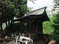 Small shrine on Tokaido Shinkansen side track in Mishima.jpg