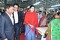 Smriti Irani accompanied by the Chief Minister of Meghalaya, Dr. Mukul Sangma and the Minister of State for Home Affairs, Shri Kiren Rijiju interacts the Apparel & Garment Making Centre, at Hatisil, Ampati, in Meghalaya.jpg