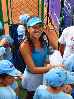 Sorana Cîrstea signing autographs for ball boys at the 2011 BCR Open Romania Ladies.jpg
