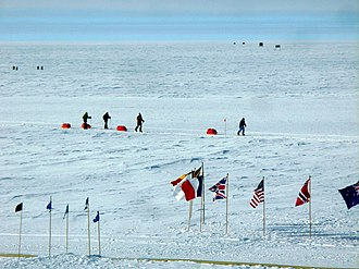Tourism in Antarctica - A party of skiers arrives after traversing overland to the South Pole, December 2009