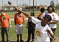 Special Olympic athletes and local volunteers participate as athletes compete in shot-put event, during the Special Olympics, at Fort Gordon, Ga., Mar 100324-A-NF756-025.jpg