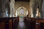 The interior of St Mary's Church, showing the stained glass windows and various plaques on the walls