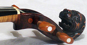 Scroll (music) - Carved lion's head on a Stainer violin