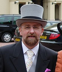 Stephen Whittle (OBE) at Buckingham Palace (cropped).jpg