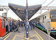 Stratford station in London is shared by London Underground trains (left) and 'one' suburban rail services (right).