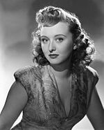 Black-and-white publicity photo of Celeste Holm .