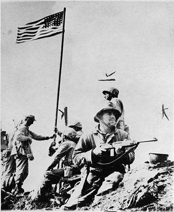 First flag set atop Mt. Suribachi.
