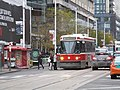TTC streetcar visible by Dundas Square, 2015 12 01 (14) (22851425704).jpg