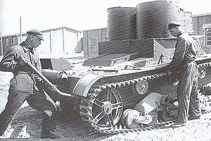 T-26 - Maintenance of the T-26 mod. 1931 (with riveted hull and turrets). This tank was produced in the first half of 1932—the exhaust silencer is mounted with two clamps and the cover over the air outlet window. The Moscow Military District. Mid-1934.
