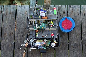 Typical tackle box with rod and bait bucket.