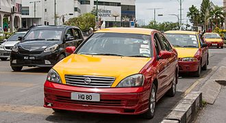 Kuching - The main taxis in the city are painted in red and yellow.