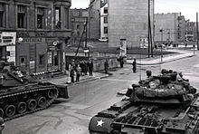Black and white photograph of US tanks at Checkpoint Charlie in 1961