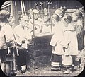 """The """"candy man"""" blowing animals out of colored molasses surrounded by children, Changde, Hunan, China, ca.1900-1919 (IMP-YDS-RG008-358-0008-0061).jpg"""