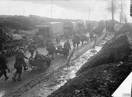 Infantrymen of the Middlesex Regiment with horse-drawn Lewis gun carts returning from the trenches near Albert, France in September 1916. In the background is a line of supply lorries. The Battle of the Somme, July-november 1916 Q1462.jpg