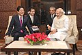 The Prime Minister, Shri Narendra Modi and the Prime Minister of Japan, Mr. Shinzo Abe in a one-on-one meeting before the start of India-Japan Business Leaders Forum, in New Delhi on December 12, 2015.jpg