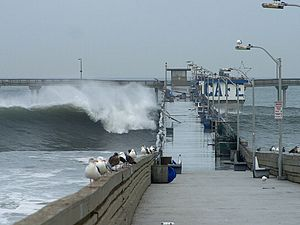 Ocean Beach, San Diego - Waves crashing over the Ocean Beach Pier in 2002