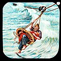 This is a boldly illustrated glass slide featuring the heroic rescuse of a child by a traditional lifeboat man, braving the dangers of the storm on a pully. (7447432366).jpg